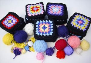 155 granny squares and yarns