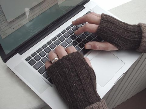 421 Thrifty Mitts at laptop